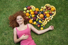 Girl with fruit Royalty Free Stock Photography