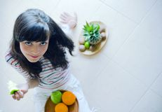 Girl with fruit. A girl on a healthy diet Royalty Free Stock Photos