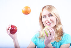 The girl with fruit Royalty Free Stock Photography