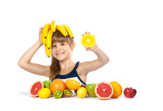 Girl with fruit and bananas Stock Photography