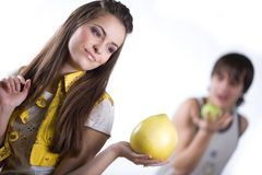 Girl with fruit and boy with apple Royalty Free Stock Photography