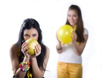 Girl with fruit and girl with balloon Stock Photo
