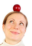 Girl with fruit on her head. Girl looking up on a balancing fruit on her head Royalty Free Stock Photography