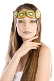 Girl with fruit make up, in the form of kiwi Stock Image