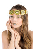 Girl with fruit make up, in the form of kiwi Royalty Free Stock Images