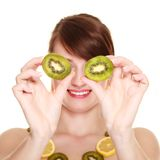 Girl in fruit necklace covering eyes with kiwi Stock Photography
