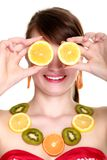 Girl in fruit necklace covering eyes with lemon Stock Photography