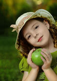 Girl with fruit in park Stock Photography