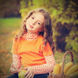 Girl with fruit in park Royalty Free Stock Image