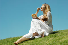 The girl with fruit salad Royalty Free Stock Photo