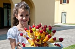 Girl with fruit on a spit Royalty Free Stock Photography