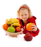 Girl and fruit vase Royalty Free Stock Photography