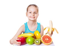 Girl with fruit Royalty Free Stock Photos