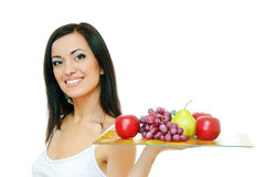 Girl with fruits Royalty Free Stock Photography