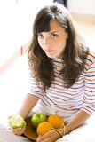 Girl with fruits. A girl with a plate of fruits Stock Images