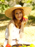 Girl with fruits in basket at garden. Stock Photo