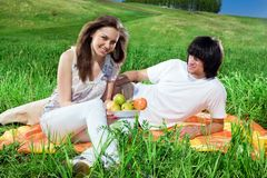 Girl with fruits and boy Royalty Free Stock Photos