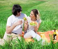 Girl with fruits and boy with wineglass Royalty Free Stock Photography