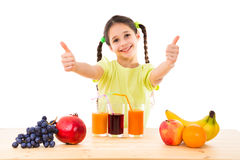 Girl with fruits, juice and thumbs up sign Royalty Free Stock Photos