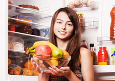 girl with fruits on the kitchen Stock Photography