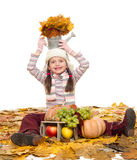 Girl with fruits and vegetables on autumn leaves Stock Images