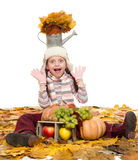 Girl with fruits and vegetables on autumn leaves Stock Photos