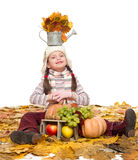 Girl with fruits and vegetables on autumn leaves Royalty Free Stock Image
