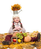Girl with fruits and vegetables on autumn leaves Royalty Free Stock Photography
