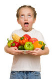 Girl with fruits and vegetables Royalty Free Stock Photos