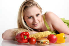 Girl with fruits and vegetarian burger Royalty Free Stock Images