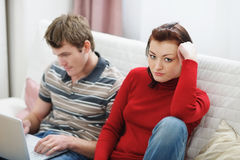 Girl frustrated that boyfriend using laptop Stock Images