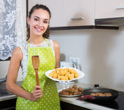 Girl frying delicious crocchette Royalty Free Stock Photo