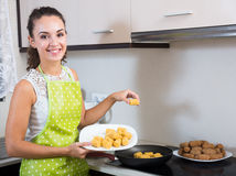 Girl frying delicious crocchette Royalty Free Stock Photography