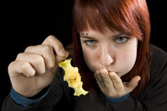 Girl Full Eating Apple. Girl almost throwing up after eating an apple Royalty Free Stock Photography