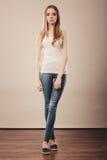Girl full length in denim trousers white blank Royalty Free Stock Images