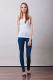 Girl full length in denim trousers white top Stock Photo