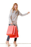 Girl in full length with red shopping bags isolated Royalty Free Stock Photos