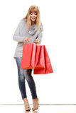 Girl in full length with red shopping bags isolated Royalty Free Stock Images