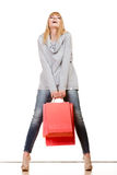 Girl in full length with red shopping bags isolated Royalty Free Stock Photography