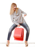 Girl in full length with red shopping bags isolated Royalty Free Stock Photo