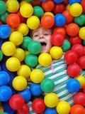 Girl in fun balls Stock Photography