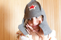 Girl in a fun hat with a red star Stock Images