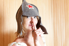 Girl in a fun hat with red star close up Stock Image
