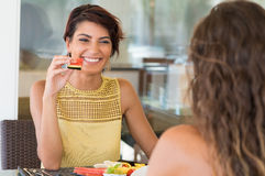 Girl Fun With Her Friend. Happy Woman Holding Watermelon Slice In Front Of Female Friend Royalty Free Stock Photos
