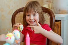 The girl is fun painting eggs for Easter royalty free stock photos