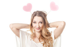Girl fun posing with two hearts in studio Royalty Free Stock Photography