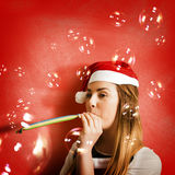 Girl in fun red christmas celebration Royalty Free Stock Photos