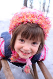 Girl fun on the snow with sledge Stock Photography