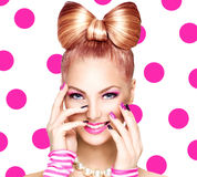 Girl with funny bow hairstyle Stock Photography