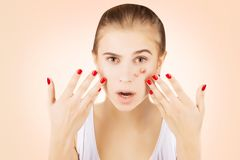 Girl with acne, pink gradient background royalty free stock image